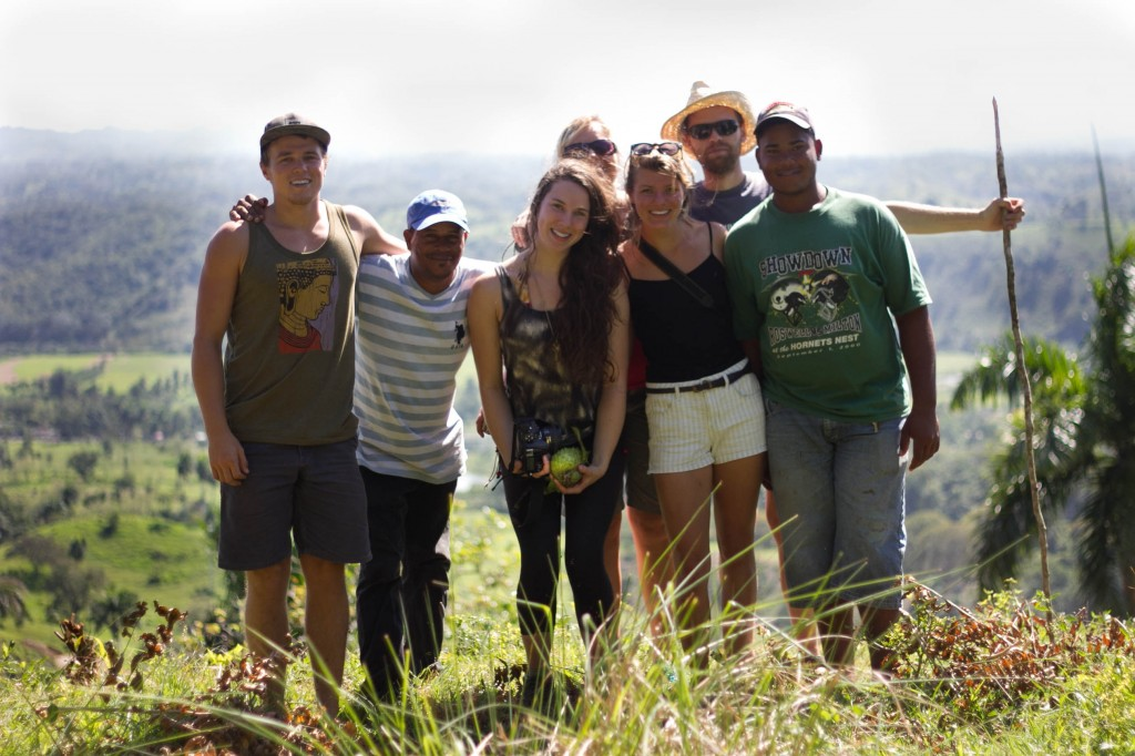 Taino Organic Farm volunteers as well as permaculture designer Charlie Durrant and farmers Victor and Juan Carlos atop a mountain overlooking Los Brazos, Dominican Republic