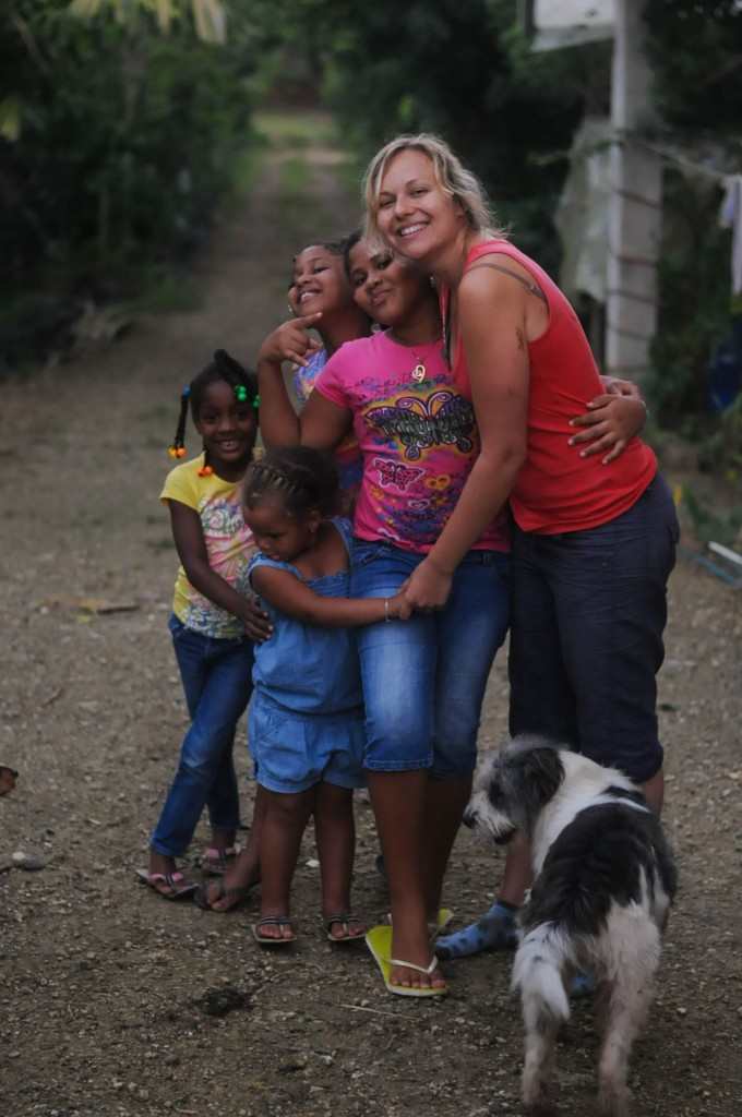 Taino Organic Farm volunteer Karin with local kids at the farm.
